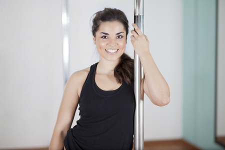 Portrait of a cute young woman loving her pole fitness class