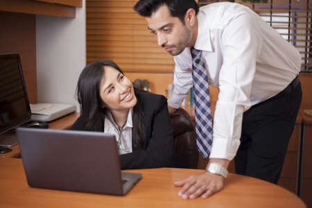 Beautiful young businesswoman flirting with her colleague at work Stock Photo - 19168197