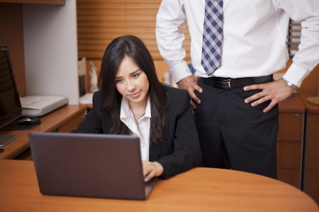 harassment: Young businesswoman being sexually harassed at work