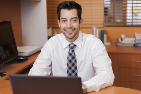 Young handsome businessman loving his job photo