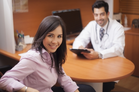 nutritionist: Beautiful latin brunette at the doctor s office Stock Photo