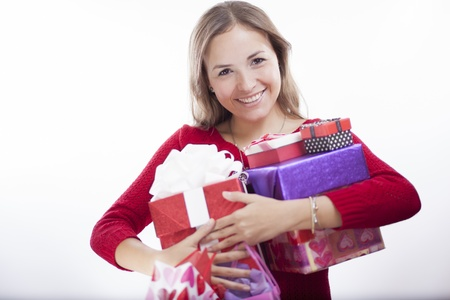 Happy young woman carrying a ton of gifts she got for valentine s day