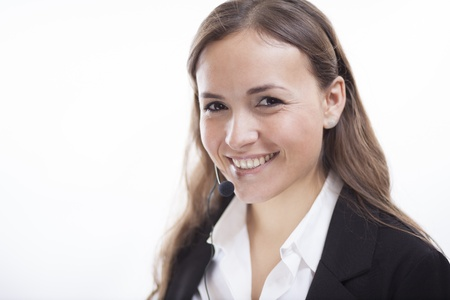 contact center: Gorgeous contact center representative taking a call and smiling Stock Photo