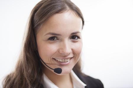 excellent customer service: Portrait of a cute contact center representative smiling