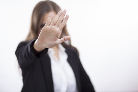 Business woman making a stop gesture with her hand