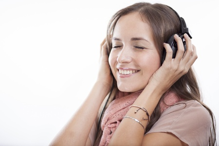 Happy young woman listening to some music photo