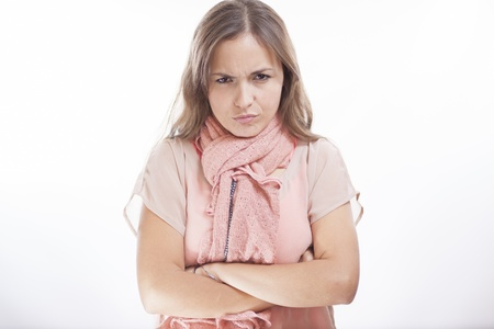 disapproving: Cute young woman frowning and disapproving