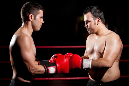 circular muscle: A couple of boxers bumping fists before a fight Stock Photo
