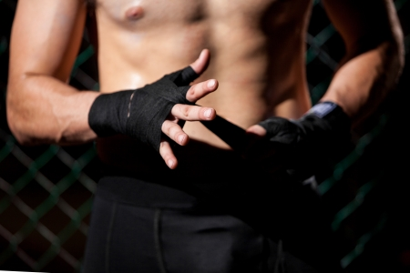 mixed martial arts: Closeup of a mixed martial arts fighter wrapping his hands before a fight
