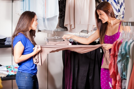 sales person: Two women fighting and pulling the same pair of pants for themselves