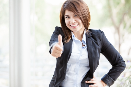 asian architect: Pretty business woman acting all excited and giving a thumb up and smiling