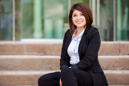 asian architect: Happy female business school student sitting outside and relaxing Stock Photo