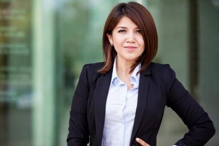 architect: Portrait of a beautiful Asian - Hispanic businesswoman outdoors