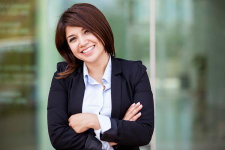 Portrait of a happy Hispanic businesswoman Stock Photo - 22225198