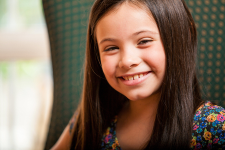 Portrait of a beautiful little girl smiling and having fun Stock Photo - 22763910