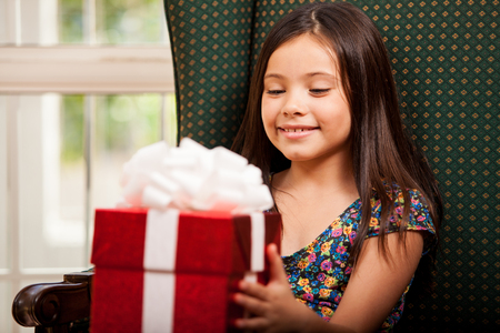Beautiful little girl with a present she just received for her birthday Stock Photo - 22568594