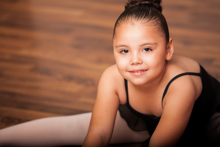 chubby girl: Portrait of a Hispanic and chubby little girl wearing a ballet outfit and smiling