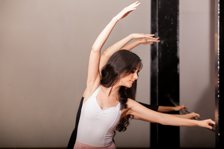 barre: Beautiful women practicing ballet in a barre at a dance academy