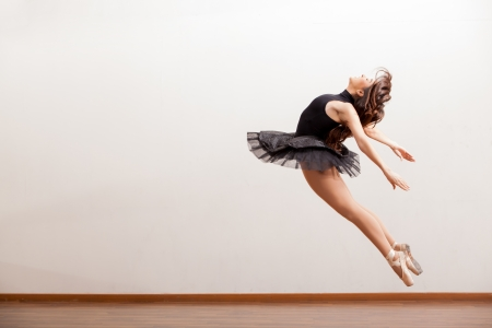 rehearsal: Beautiful ballerina in a tutu up in the air as part of a ballet dance routine Stock Photo