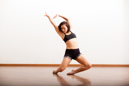 moves: Cute female jazz dancer during a dance rehearsal in a studio Stock Photo
