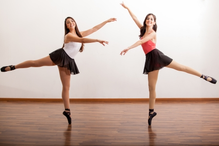 Beautiful ballet dancers rehearsing a dance routine in a dance academy
