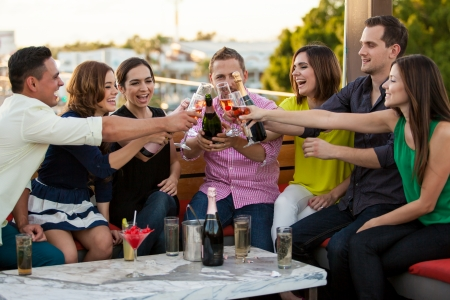 Big group of friends having fun and toasting with champagne in a terrace Stock Photo - 23562612