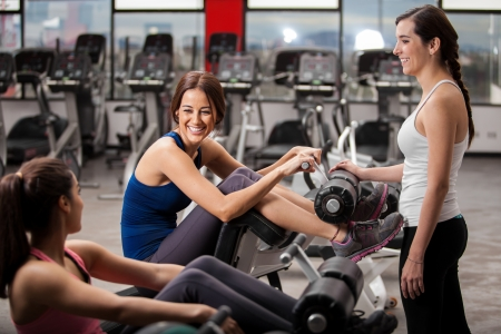 gym girl: Pretty female Latin friends talking and having fun during a break at the gym
