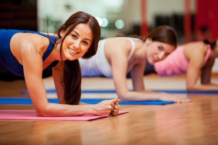 fun: Happy female friends exercising and having fun in a gym class Stock Photo