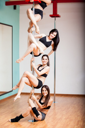 Cute pole fitness students having a good time during class