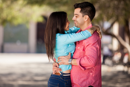 romantically: Pretty young couple hugging and looking at each other romantically Stock Photo
