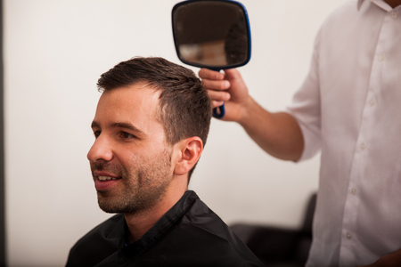 haircut: Young man just got a new haircut in a barber shop Stock Photo