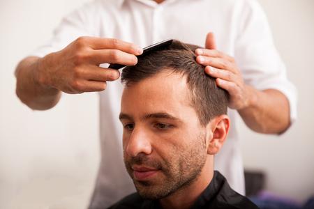 haircut: Young Hispanic man getting a haircut at a barber shop