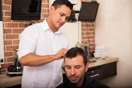 haircut: Young man getting a haircut at a barber shop