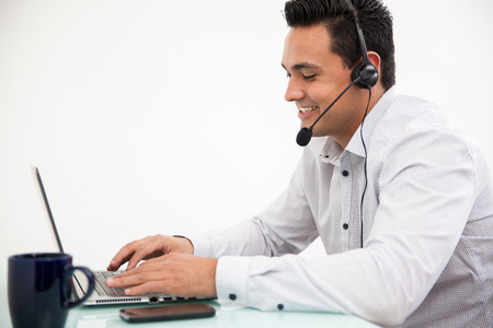 Customer service representative taking a call from a customer and smiling