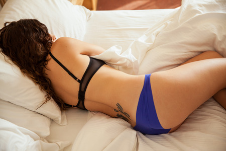 hotel bedroom: Top view of a gorgeous girl sleeping in her underwear in a bed