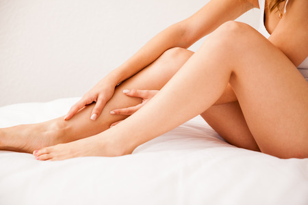human leg: Close up of some beautiful and smooth legs from a young woman who just removed all hair Stock Photo