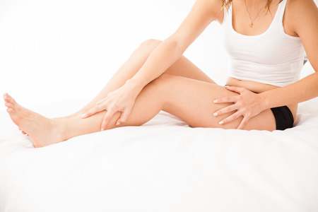 Closeup of the recently epilated and smooth legs of a young woman photo