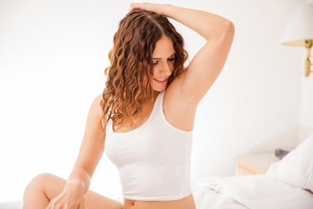 armpits: Happy young brunette showing off her recently depilated and smooth armpits Stock Photo