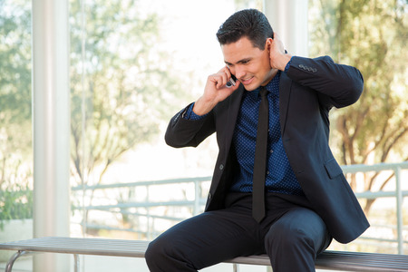 Young man on a suit stressing out from bad news he just heard over the phone Reklamní fotografie