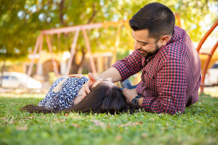 Young man with a beard relaxing with his girlfriend at a park