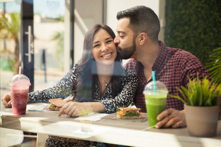 healthy lunch: Portrait of a young couple smiling and having a healthy lunch together Stock Photo
