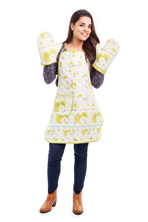 mitts: Beautiful young woman wearing an apron and some oven mitts Stock Photo