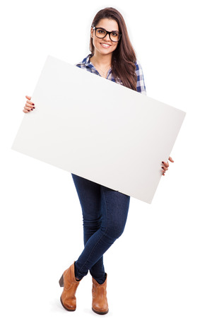 woman wearing glasses: Gorgeous young Hispanic woman wearing glasses and holding a big white sign