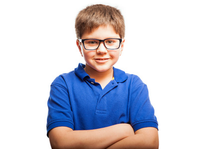 preadolescent: Cute blond boy wearing glasses and with his arms crossed smiling Stock Photo