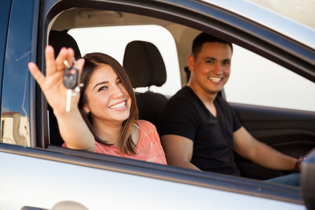 brand new: Portrait of a couple of happy  newlyweds enjoying their brand new car