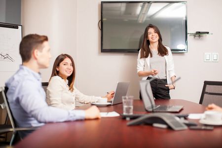 Portrait of a gorgeous young woman giving a business presentation in a meeting room
