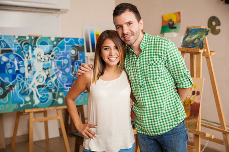 Good looking young couple attending an art workshop on a date and having fun Archivio Fotografico