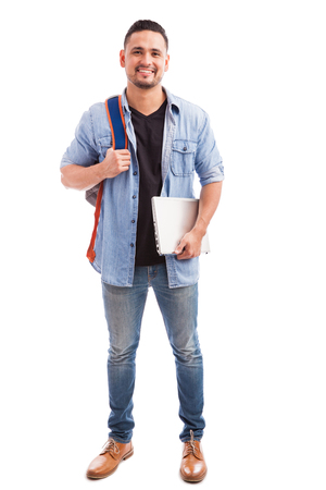 adult  male: Full length portrait of a young man going to school with a laptop computer and a backpack
