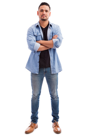 white man: Good looking young man with casual clothes standing against a white background in a studio Stock Photo