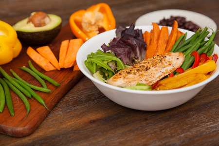 green bean: Healthy dish with chicken served on a bowl with lettuce, sweet potato, avocado, pepper and green beans